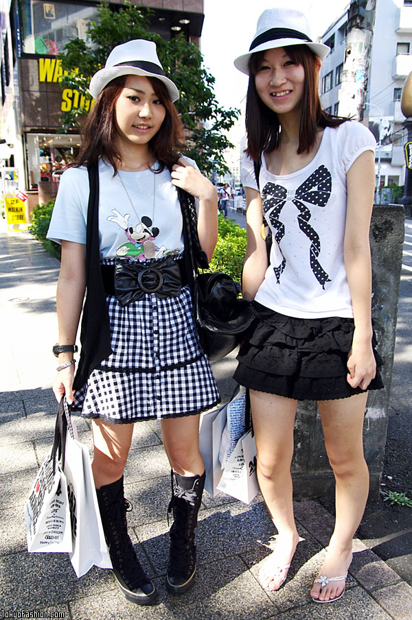 The girl on the right is wearing a jeweled t-shirt with a big bow,