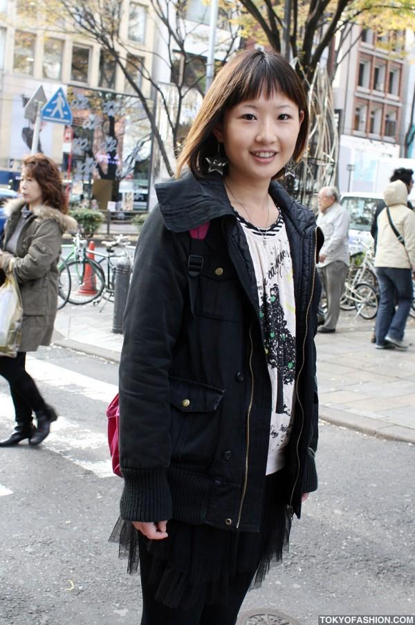 Smiling Girl in ScoLar T-Shirt