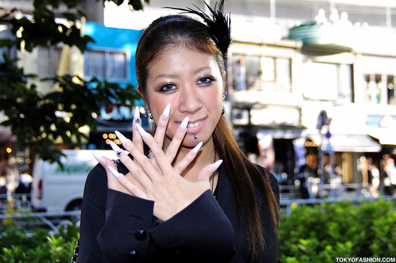 Asian long nail woman