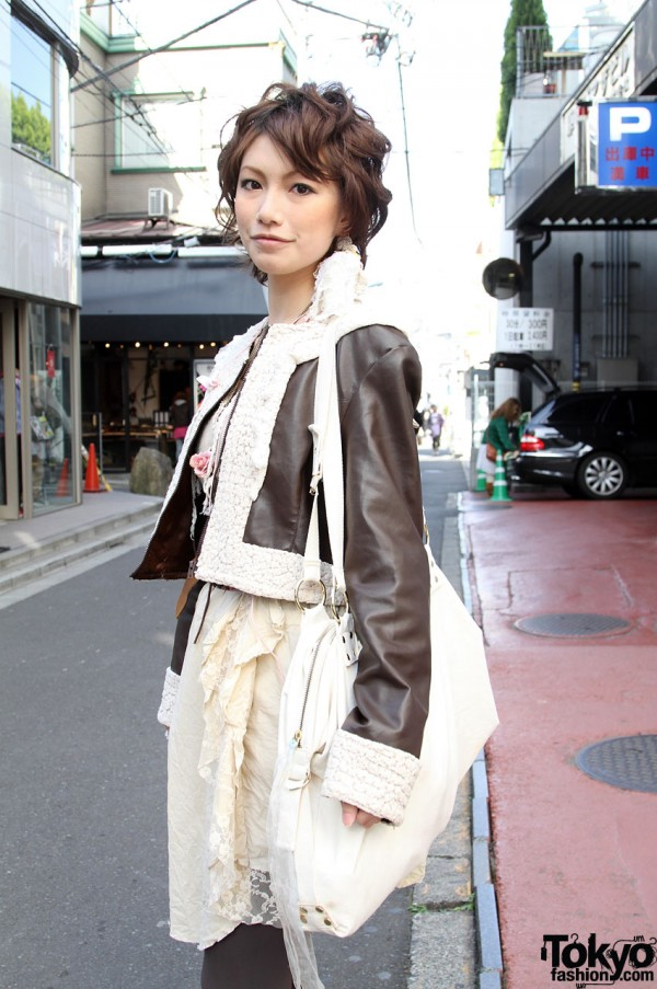 Brown leather jacket and large white vintage bag
