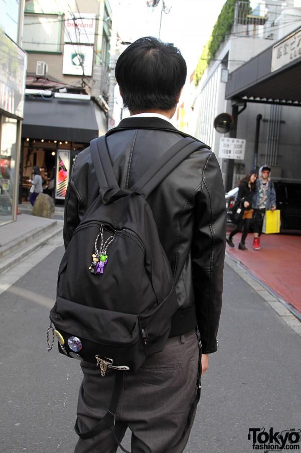 Black packpack and hanging suspenders in Harajuku