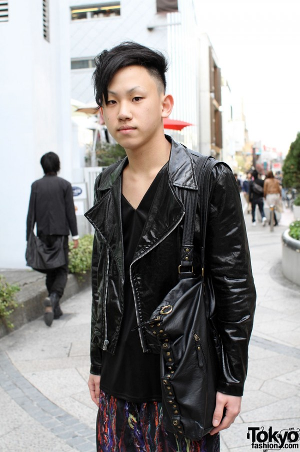 Trendy haircut with black leather jacket and bag