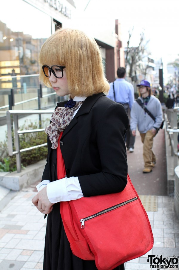 Japanese girl with blonde bob and red Marimekko bag