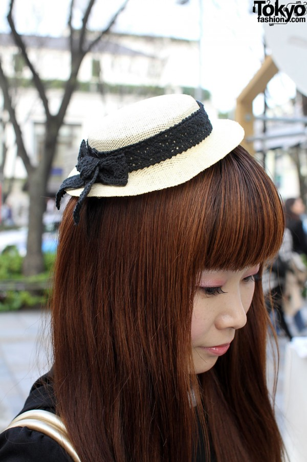 Small straw hat and long auburn hair