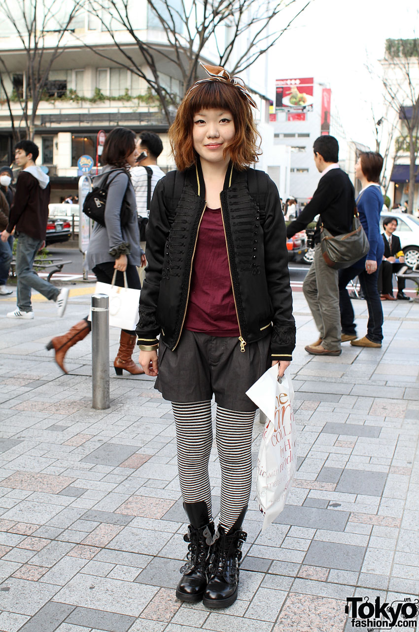 Friendly Japanese Girl in Striped Tights and Hair Bow