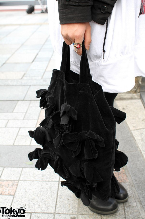 Black velveteen bag from Comme des Garcons
