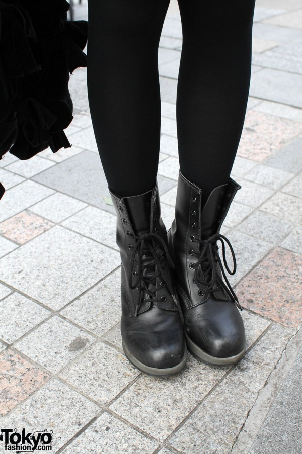 Black tights and Dr. Martens boots in Harajuku