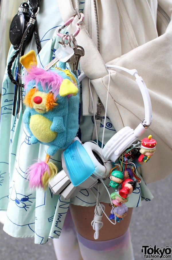 Lad Musician bag with headphones and toys