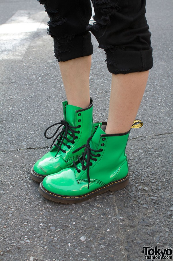 Green Dr. Martens with cuffed skinny jeans
