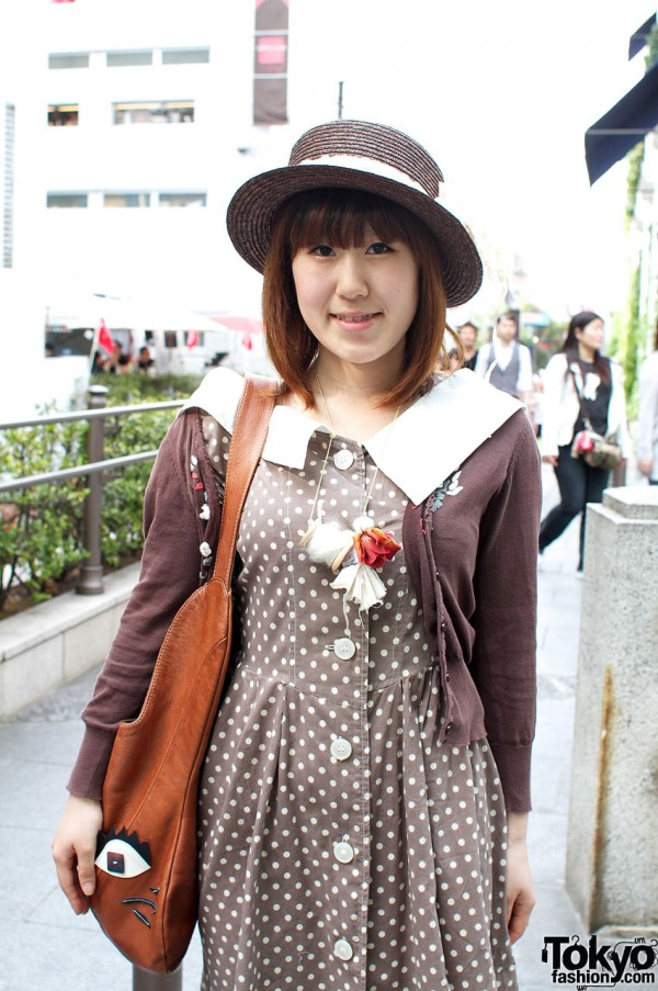 Japanese girl with vintage brown dress and brown straw hat