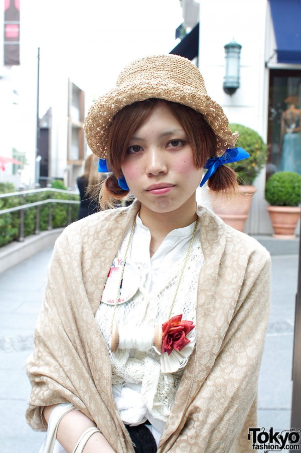 Straw hat and blue hair ribbons