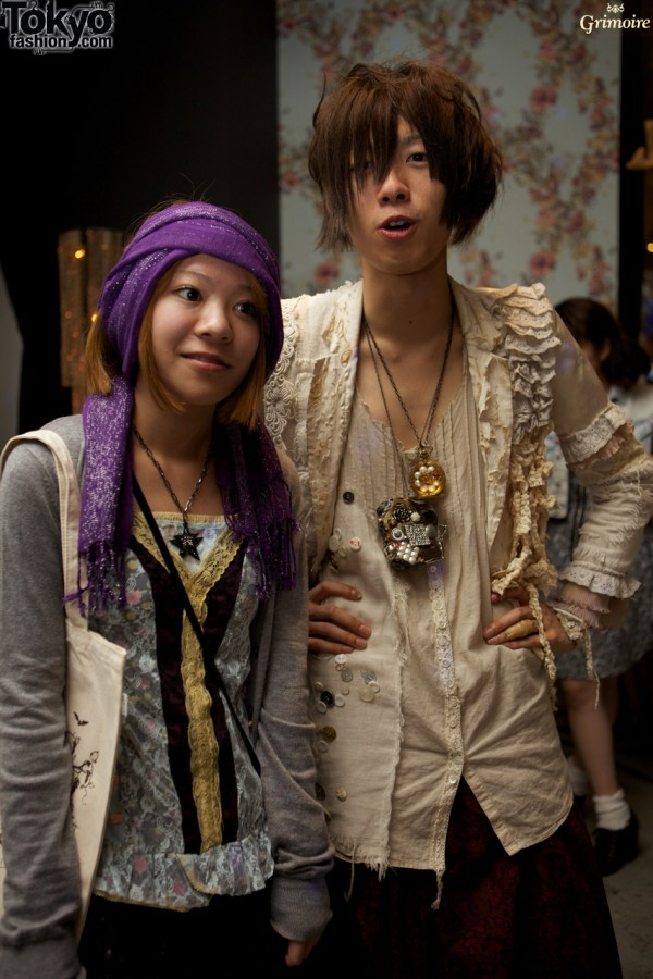 Cool girl at guy at the Grimoire party.