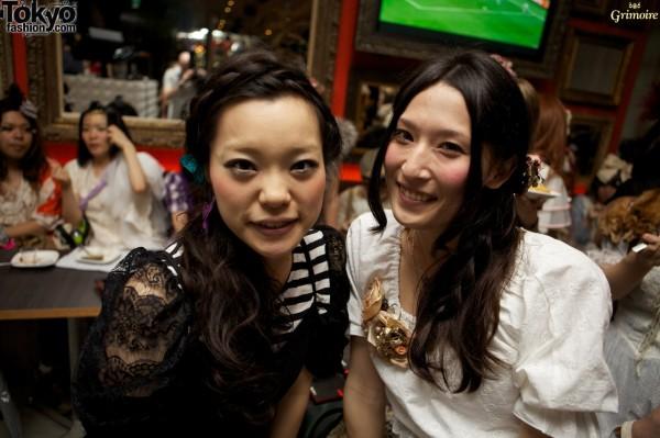 Smiling girls celebrating Grimoire.