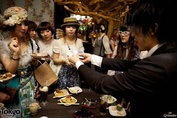 A magician works his magic at the Grimoire anniversary party.