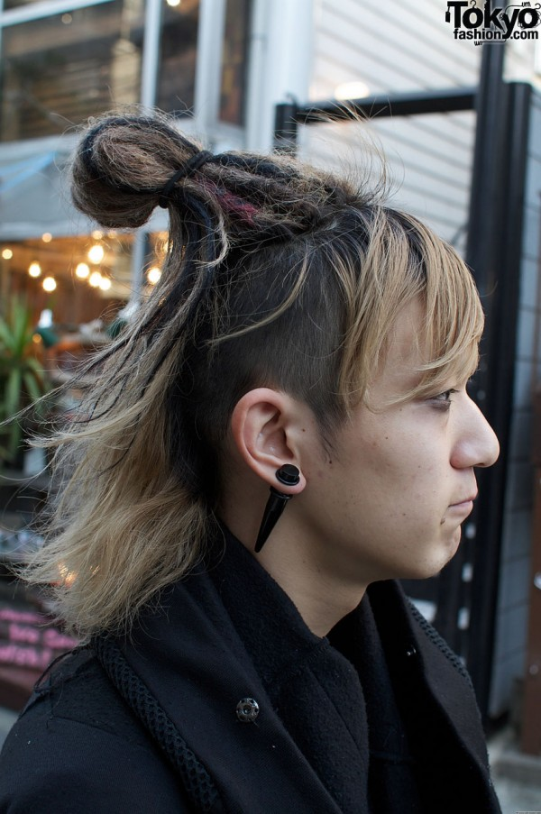 Dreadlocks and ear spike