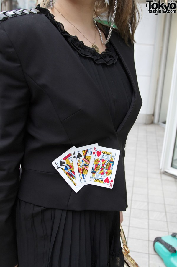 Black jacket decorated with playing cards