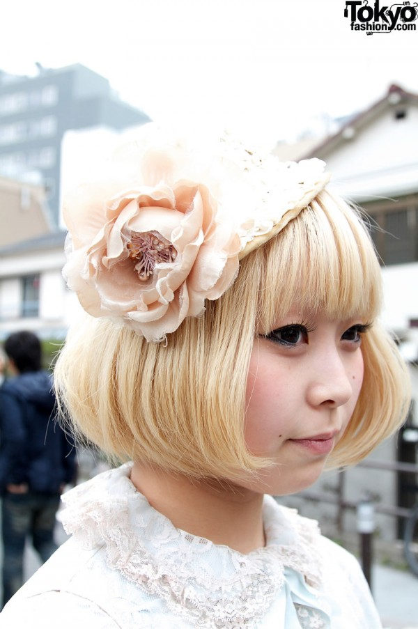 Cute blonde girl with small straw hat & large flower