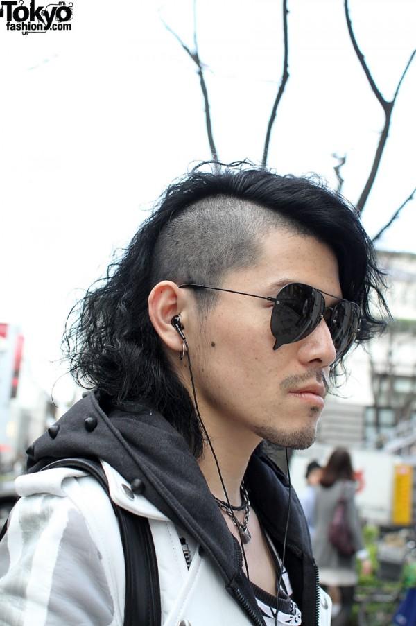 Asymmetrical shaved hair & cool sunglasses