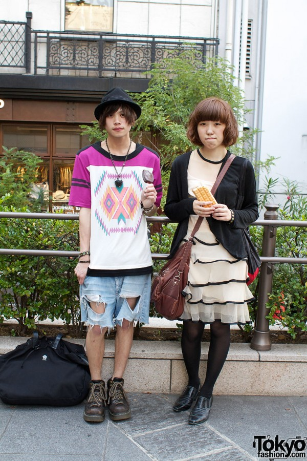 Japanese guy in hat & girl in ruffled Anna Suit dress