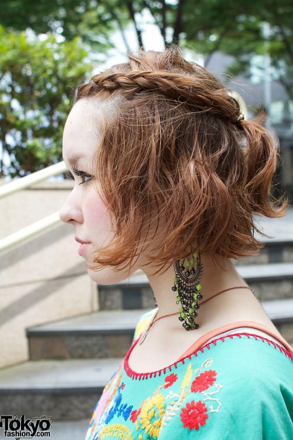 Braided auburn hair & long bead earrings