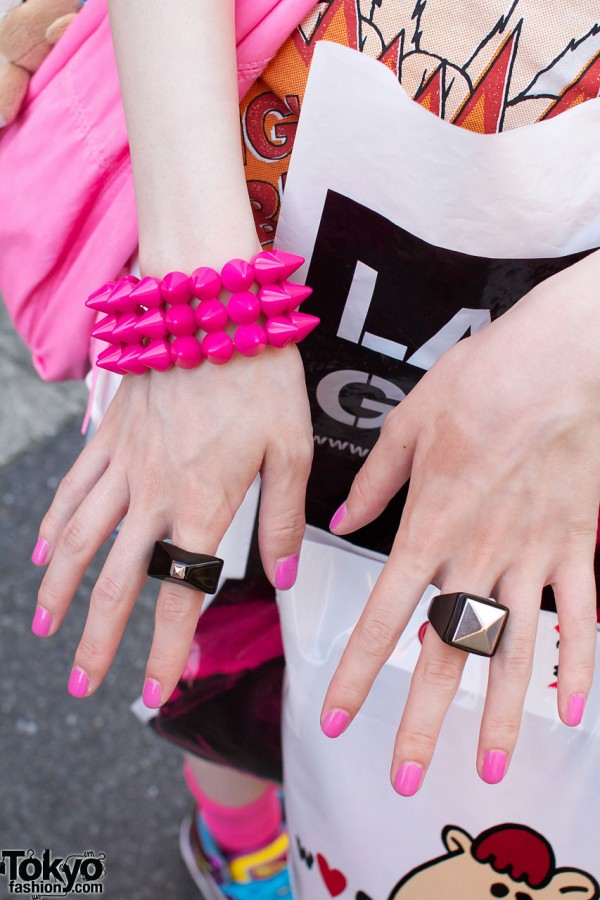 Pink bracelet with black & silver rings