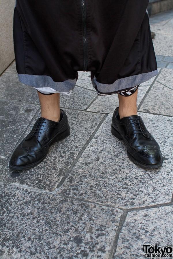Black wingtip shoes
