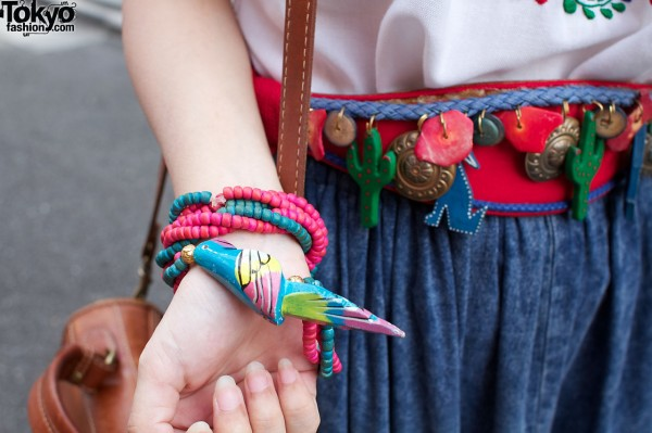 Strands of beads & painted bird
