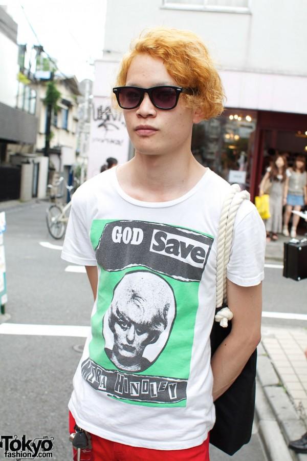 Red hair, sunglasses & shock t-shirt