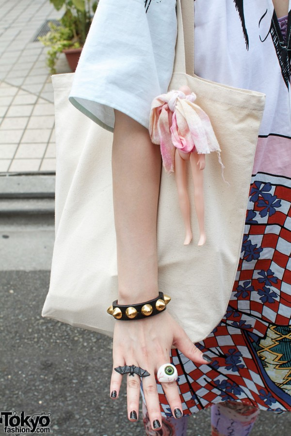 Studded bracelet & bag with doll body
