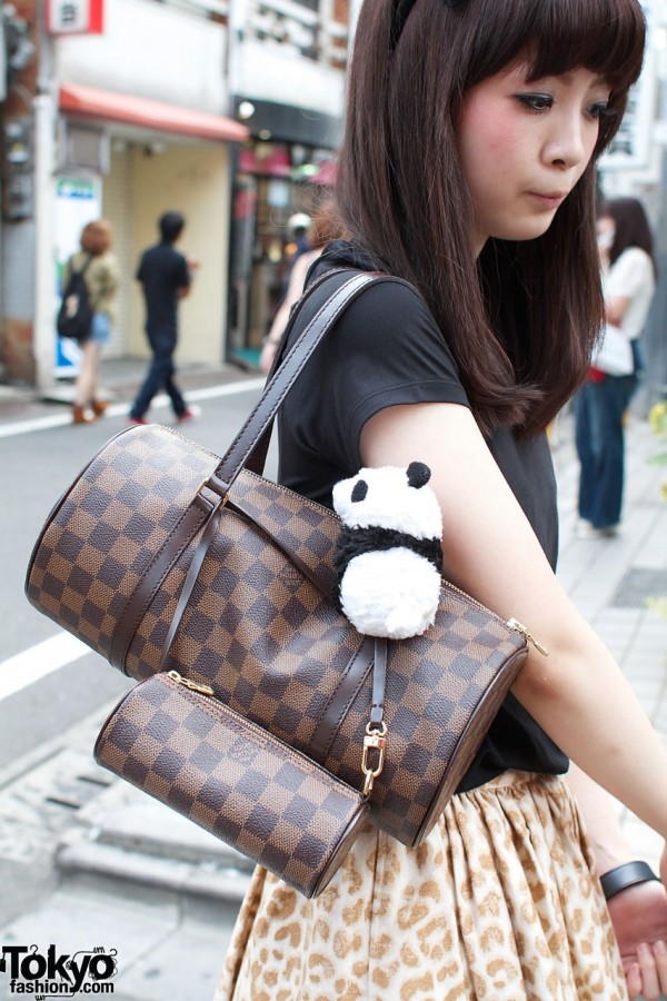 Louis Vuitton bags & stuffed panda
