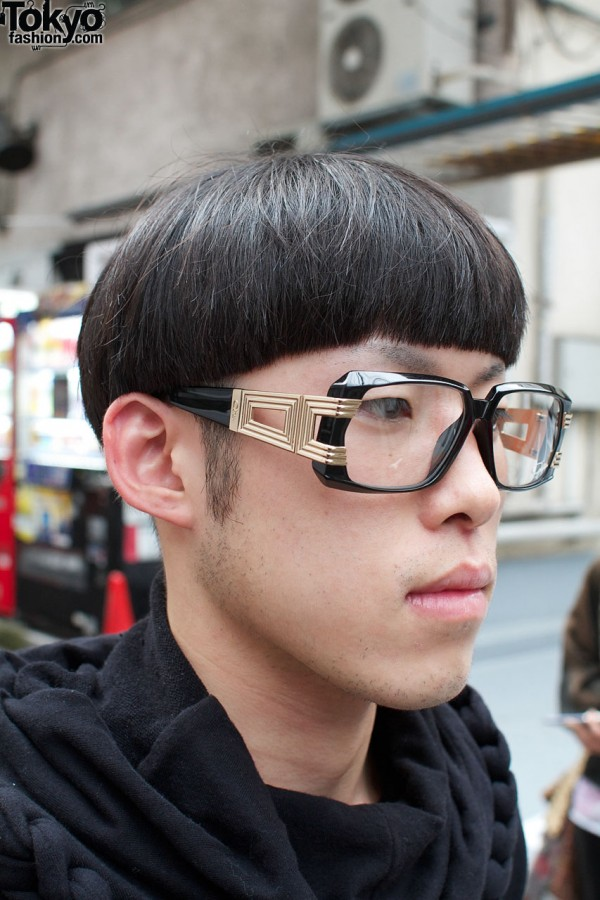 Bowl haircut & gold-trimmed glasses