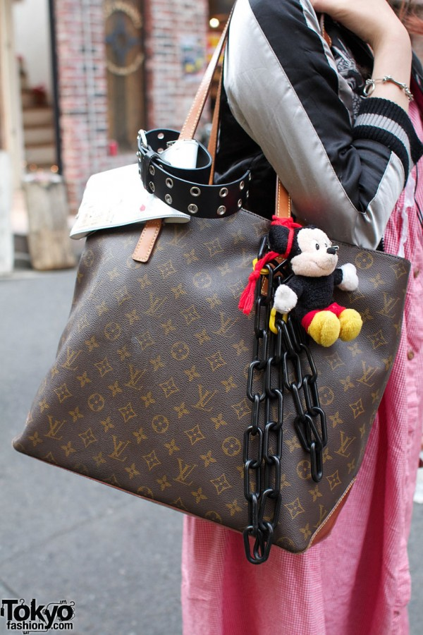 Louis Vuitton bag with Mickey Mouse toy