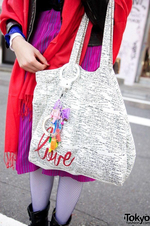 Bag with decorated handcuffs