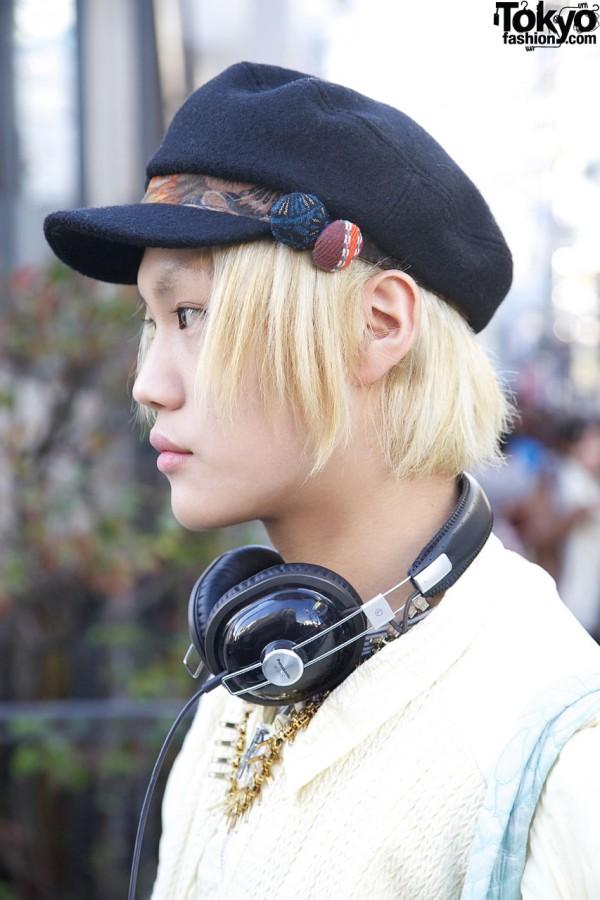 Blonde hair & black cap