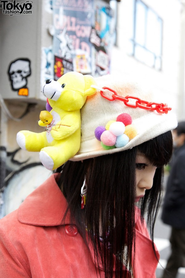 Knit hat with toy bear & pompoms