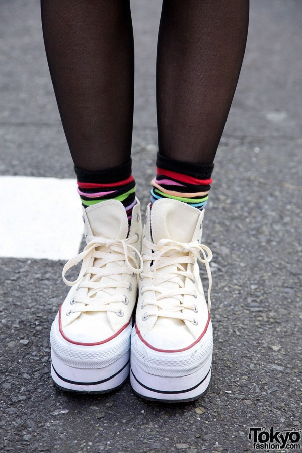 White platform sneakers with multicolored socks