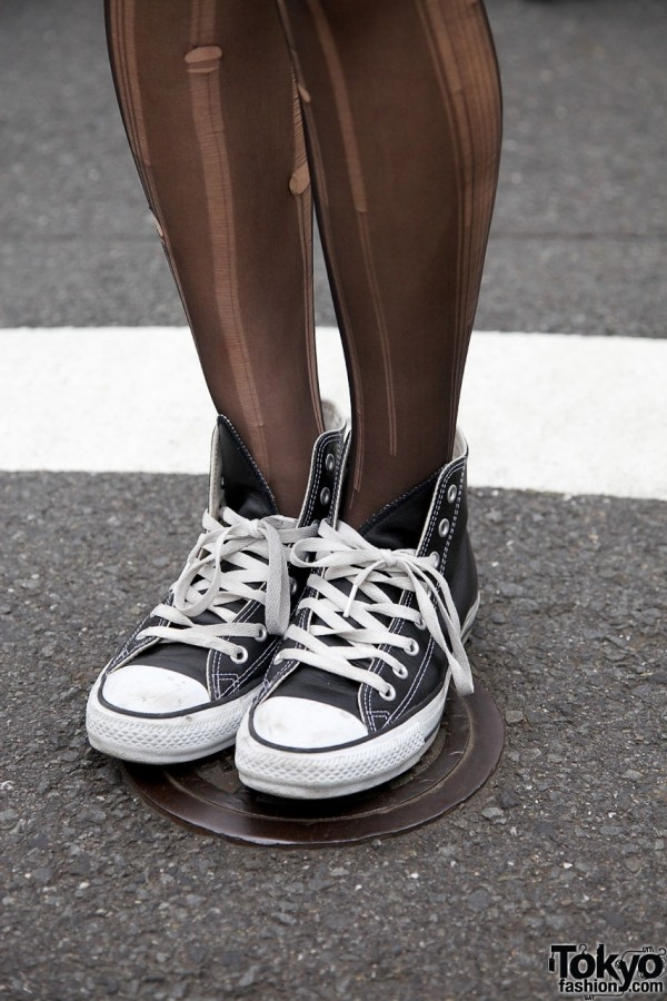 Ripped stockings & Converse sneakers