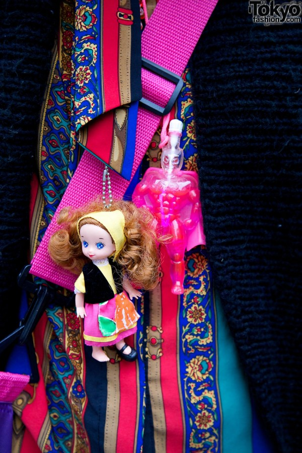 Small doll on necklace