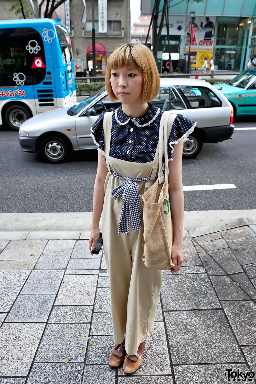 japanese girl in cute salopette with theatre products bag