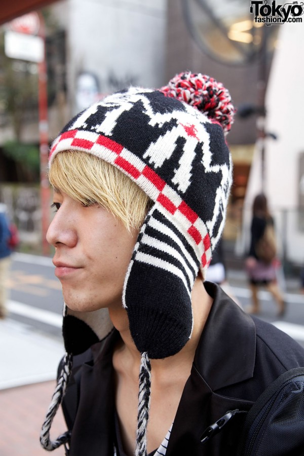 Knit cap with earflaps and pompom