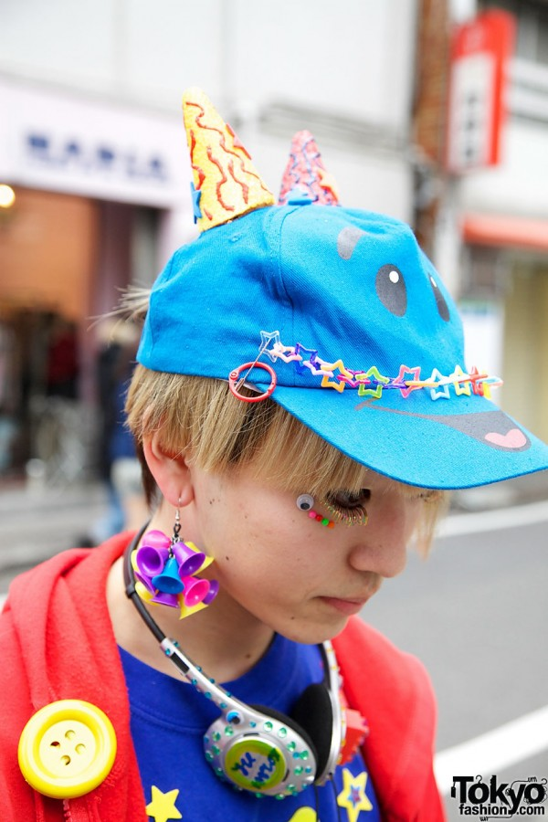 Hat with horns & plastic bell earrings