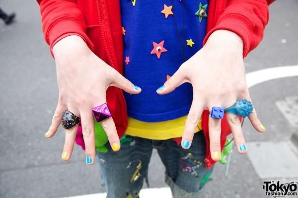 Plastic rings & multicolored nail polish