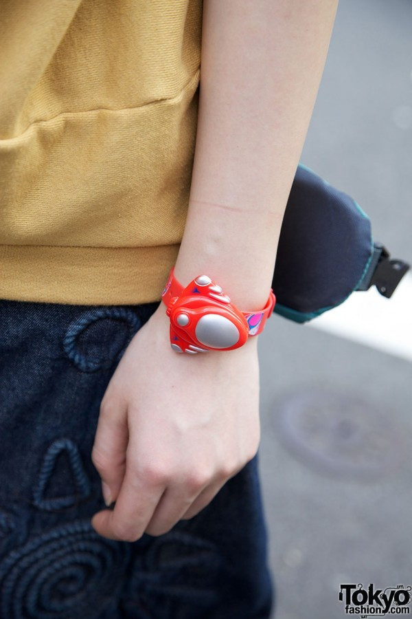 Japanese girl with toy wristwatch