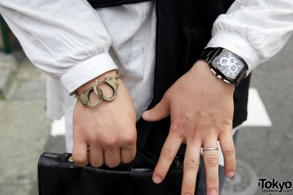 Handcuff bracelet & watch with complications