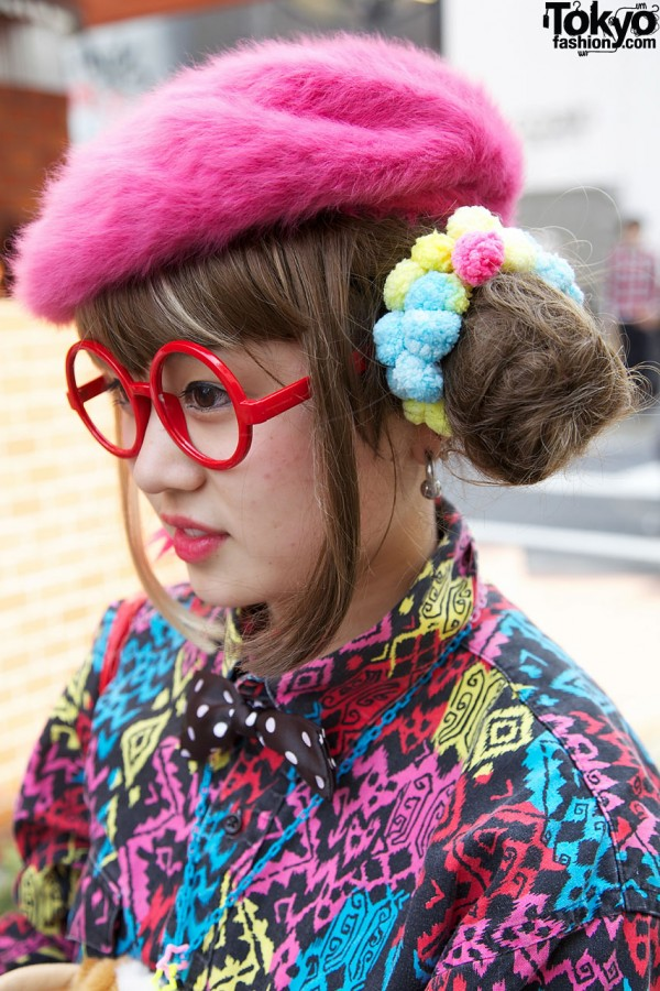 Double Bun Hairstyle & Round Glasses