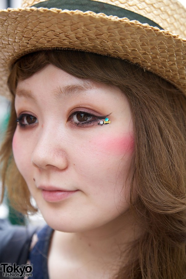 Japanese girl w/ eye makeup with sequins