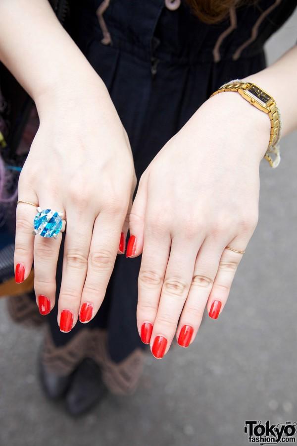 Plastic ring & red nail polish
