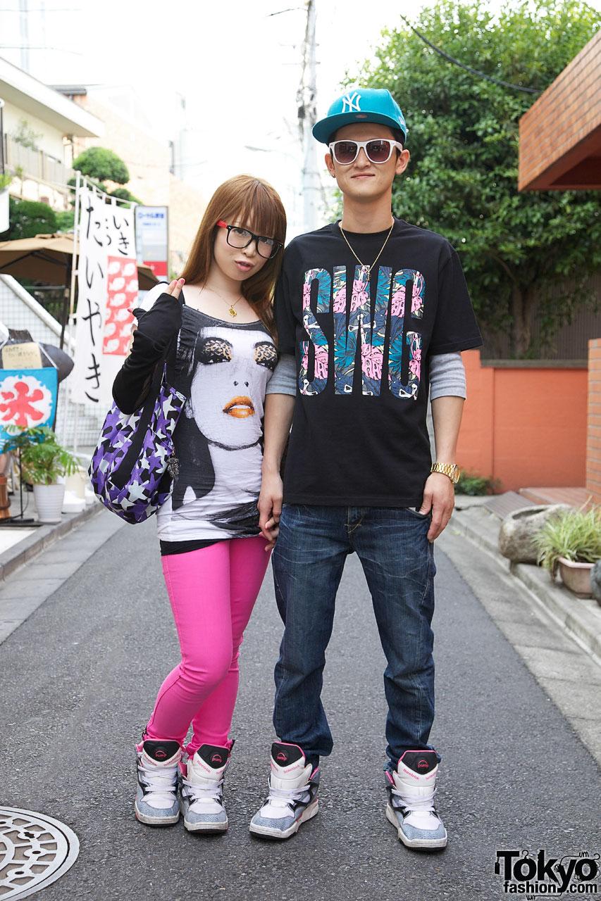 Couple in matching Reeboks Pump sneakers