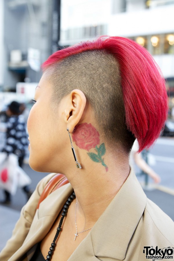 Fuchsia hair, shaved head & rose tattoo
