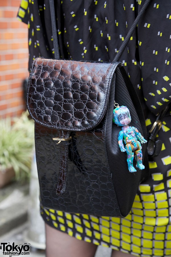 Embossed leather purse & colorful doll
